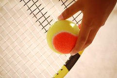 Tennis Ball. And racket. Ready to serve royalty free stock image