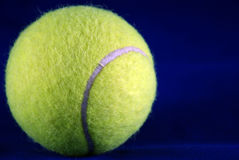 Tennis ball. Tennis ball over blue background Royalty Free Stock Image