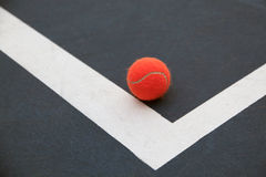 Tennis ball. Red tennis ball on practice court Stock Images