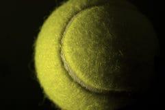 Tennis Ball. Lit on left side, with dark left side Stock Photo