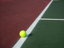 Tennis Ball. View of a tennis ball on a tennis court Stock Images