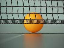 Tennis ball. Behind tennis net on the tennis table stock image