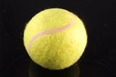 Tennis Ball. Isolated on black background Stock Photography