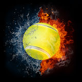 Tennis Ball. In Fire and Water Isolated on the Black Background Royalty Free Stock Images