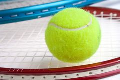 Tennis ball. And two rackets closeup Stock Photography