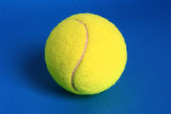 Tennis ball. On a blue background Stock Image
