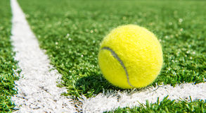 Tennis Ball. Closeup of tennis ball on grass Royalty Free Stock Images
