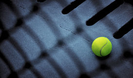 Tennis ball. A tennis ball on ground Royalty Free Stock Photography
