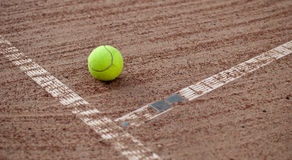 Tennis ball. Lawn tennis ball on the clay court Royalty Free Stock Image