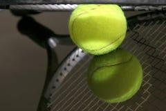 Tennis ball. New tennis ball and racket Stock Photography