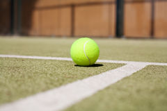 Tennis ball. And white lines Royalty Free Stock Images