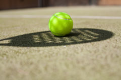 Tennis ball. And shadow on the tennis court Royalty Free Stock Photo