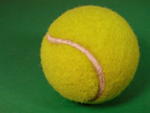 Tennis ball. On an artificial surface Stock Photos