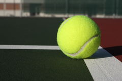 Tennis ball. On the court Royalty Free Stock Images