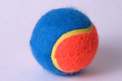 Tennis ball. Blue and orange tennis ball Stock Image