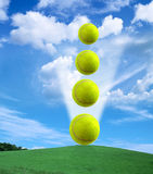 Tennis ball. Stacked tennis balls - skies moving back stock image