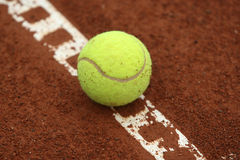 Tennis Ball. On the line Royalty Free Stock Photos