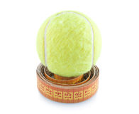 Tennis Ball And Measuring Tape Royalty Free Stock Photography