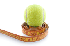 Tennis Ball And Measuring Tape Royalty Free Stock Photos