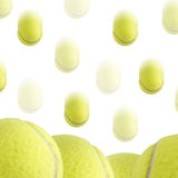 Tennis Ball Background. A bunch of tennis balls isolated on a white background. Motion blur on the falling balls Royalty Free Stock Photography