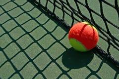 Tennis Ball Besides The Net Stock Photos