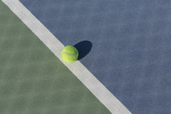 Tennis ball on blue and green hard court Stock Photo