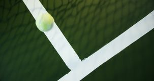 Tennis ball bouncing on white line in court 4k. Overhead view of tennis ball bouncing on white line in court 4k stock video
