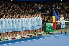 Tennis ball boys and girls during opening ceremony. CLUJ NAPOCA, ROMANIA - FEBRUARY 10, 2018: The ball boys and girls entering the court during the opening stock photography