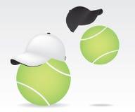 Tennis ball and cap Royalty Free Stock Photos