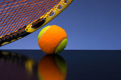 Tennis ball for children with tennis racket Royalty Free Stock Images