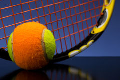 Tennis ball for children with tennis racket Stock Photography