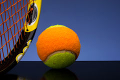 Tennis ball for children with tennis racket Stock Photos
