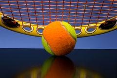Tennis ball for children with tennis racket Stock Images