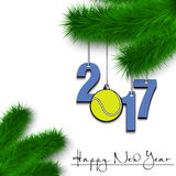Tennis ball and 2017 on a Christmas tree branch Royalty Free Stock Photography