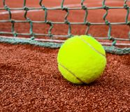 Tennis ball on clay royalty free stock images