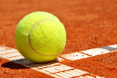 Tennis ball. On a tennis clay court Stock Images