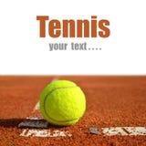 Tennis ball. On a tennis clay court Stock Photo