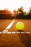 Tennis ball on a clay court royalty free stock photo