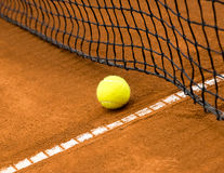 Tennis ball on a clay court Royalty Free Stock Images