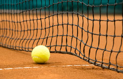Tennis ball on a clay court Royalty Free Stock Photos