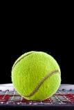 Tennis ball closeup on black background Royalty Free Stock Photos