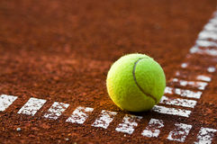 Tennis ball and court Royalty Free Stock Photo