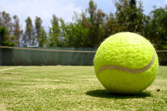 A tennis ball on a court Stock Photo
