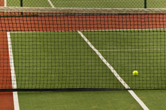 A tennis ball on a court Royalty Free Stock Photo