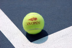 Tennis Ball on the court (2). US Open Tennis Ball on a hard court Royalty Free Stock Image