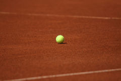 Tennis ball on the court. Bright tennis ball on the court Royalty Free Stock Photography