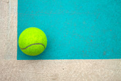 A tennis ball on court. A tennis ball on Sky blue court Stock Photo