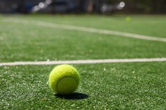 Tennis ball on a court Royalty Free Stock Photography