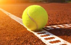 Tennis ball. On a tennis court Royalty Free Stock Photos