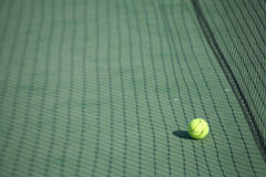 Tennis ball on a court Royalty Free Stock Image